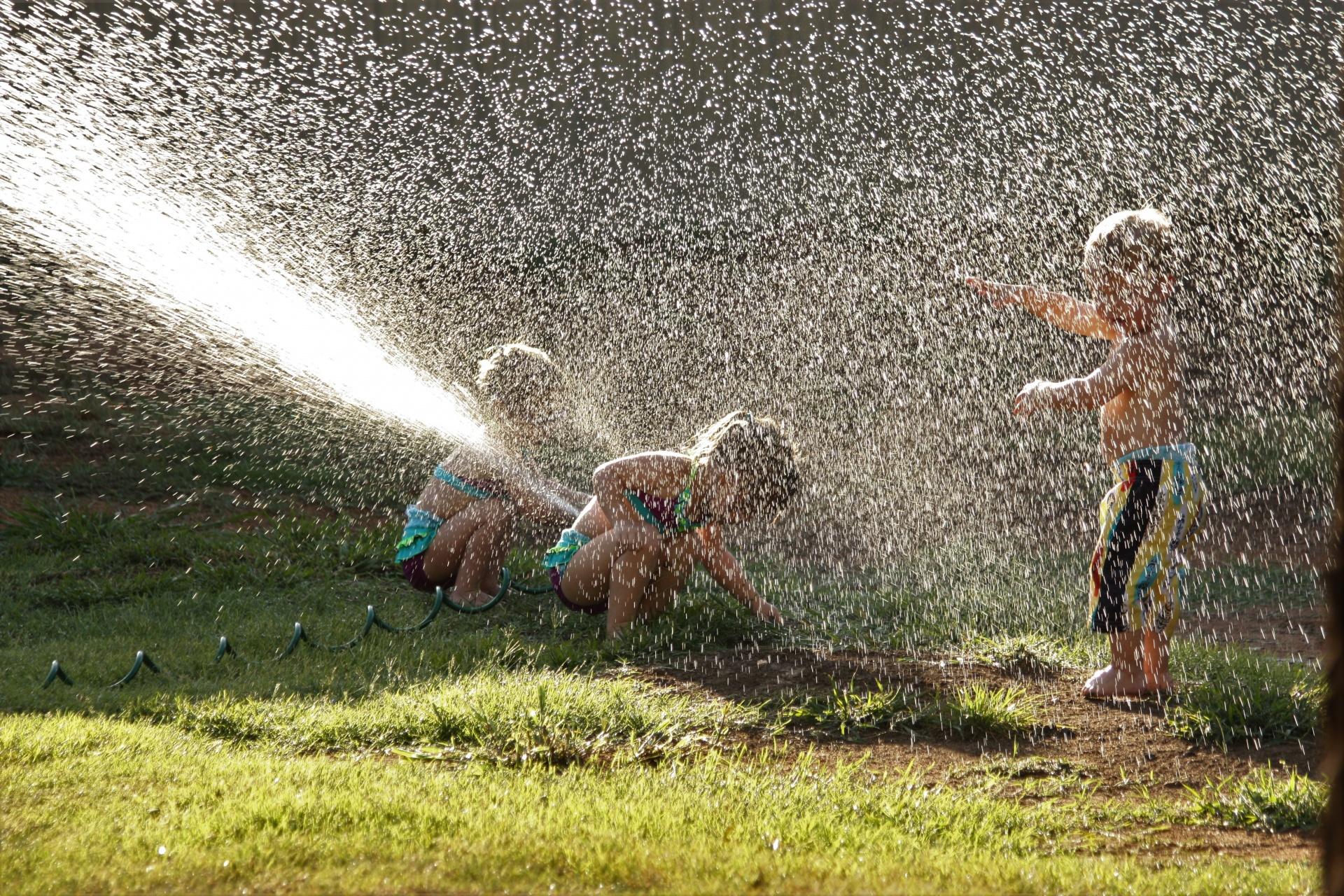 children in sprinkler