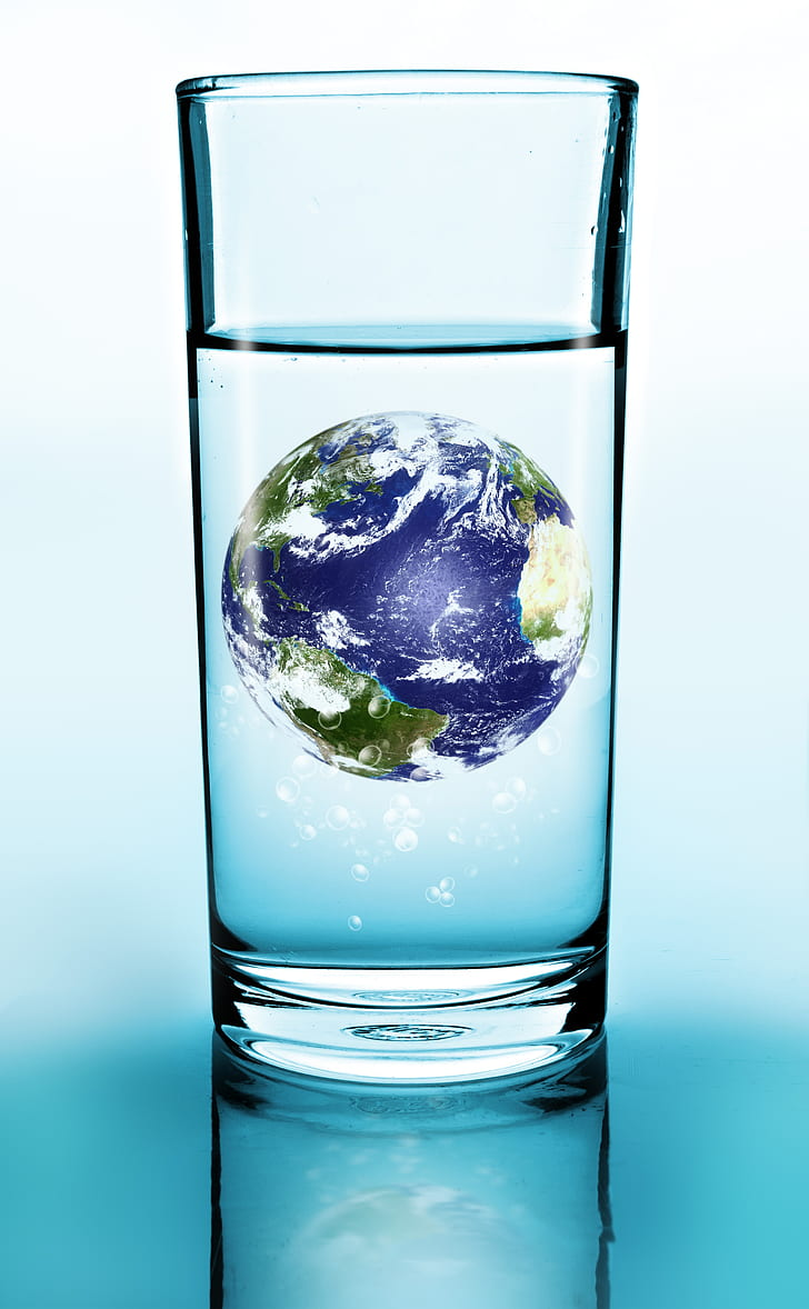 water glass with earth