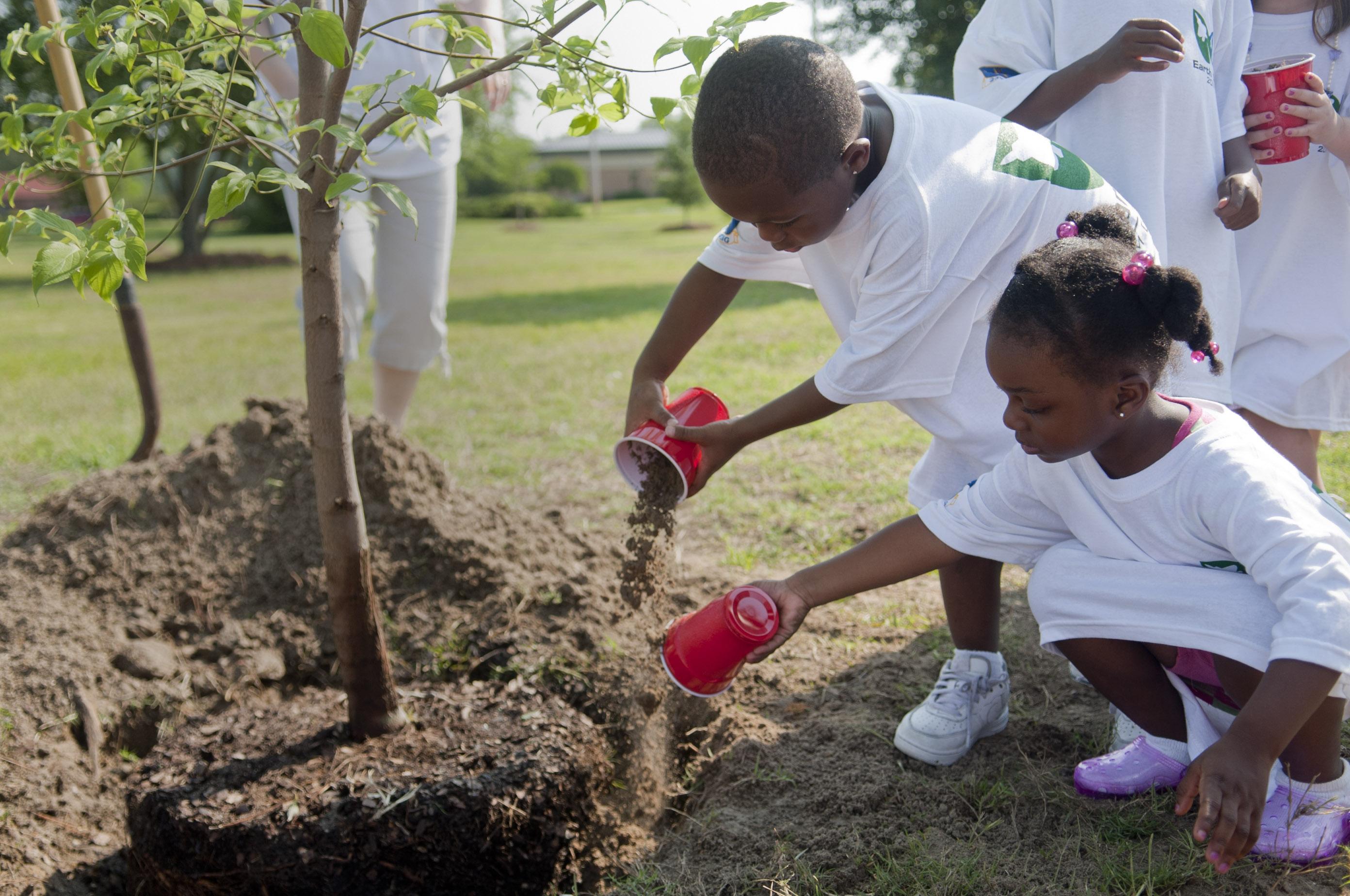 children planting tress