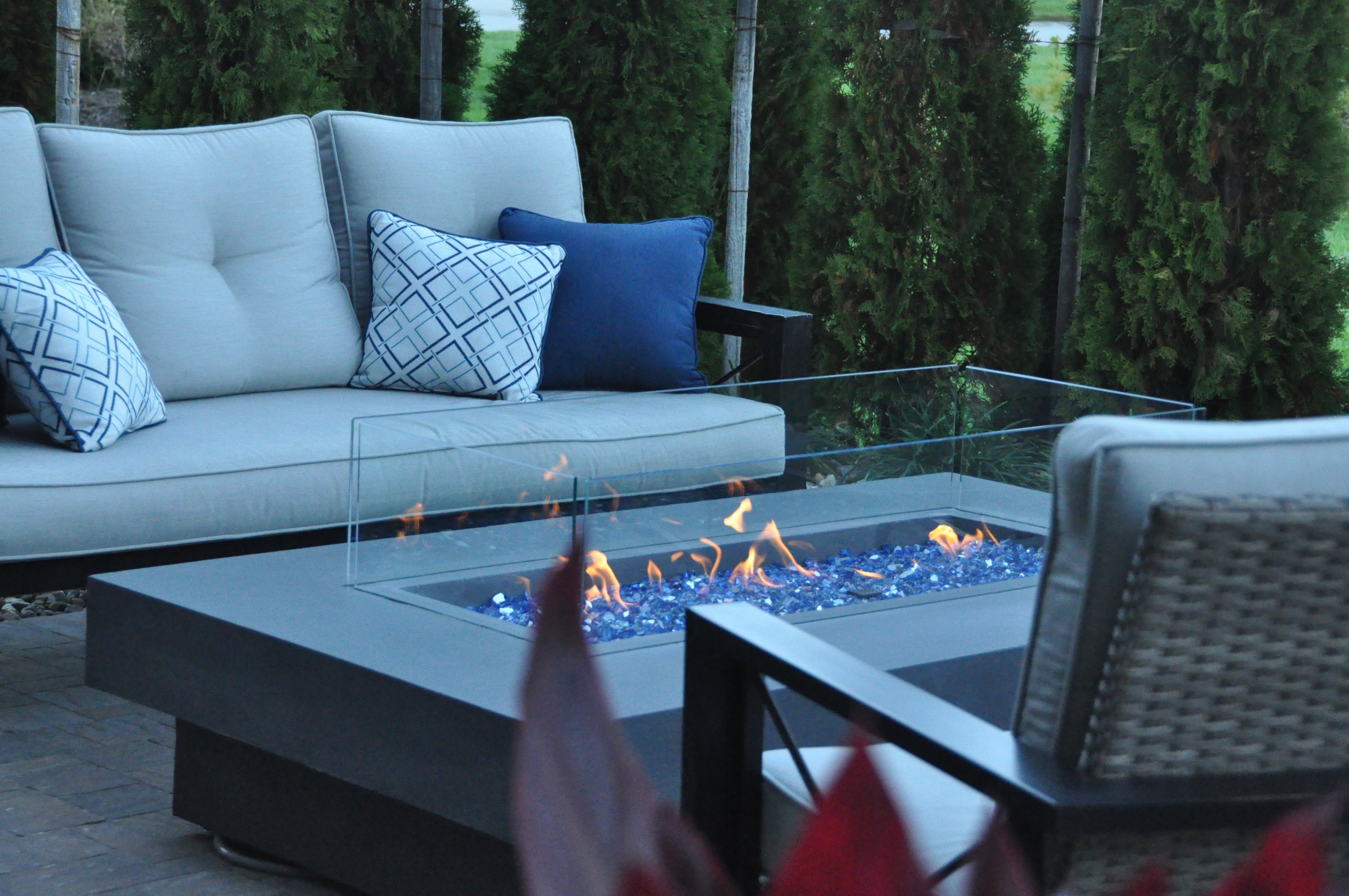 Using glass pebbles gives a sleek, modern feel to the fire pit.