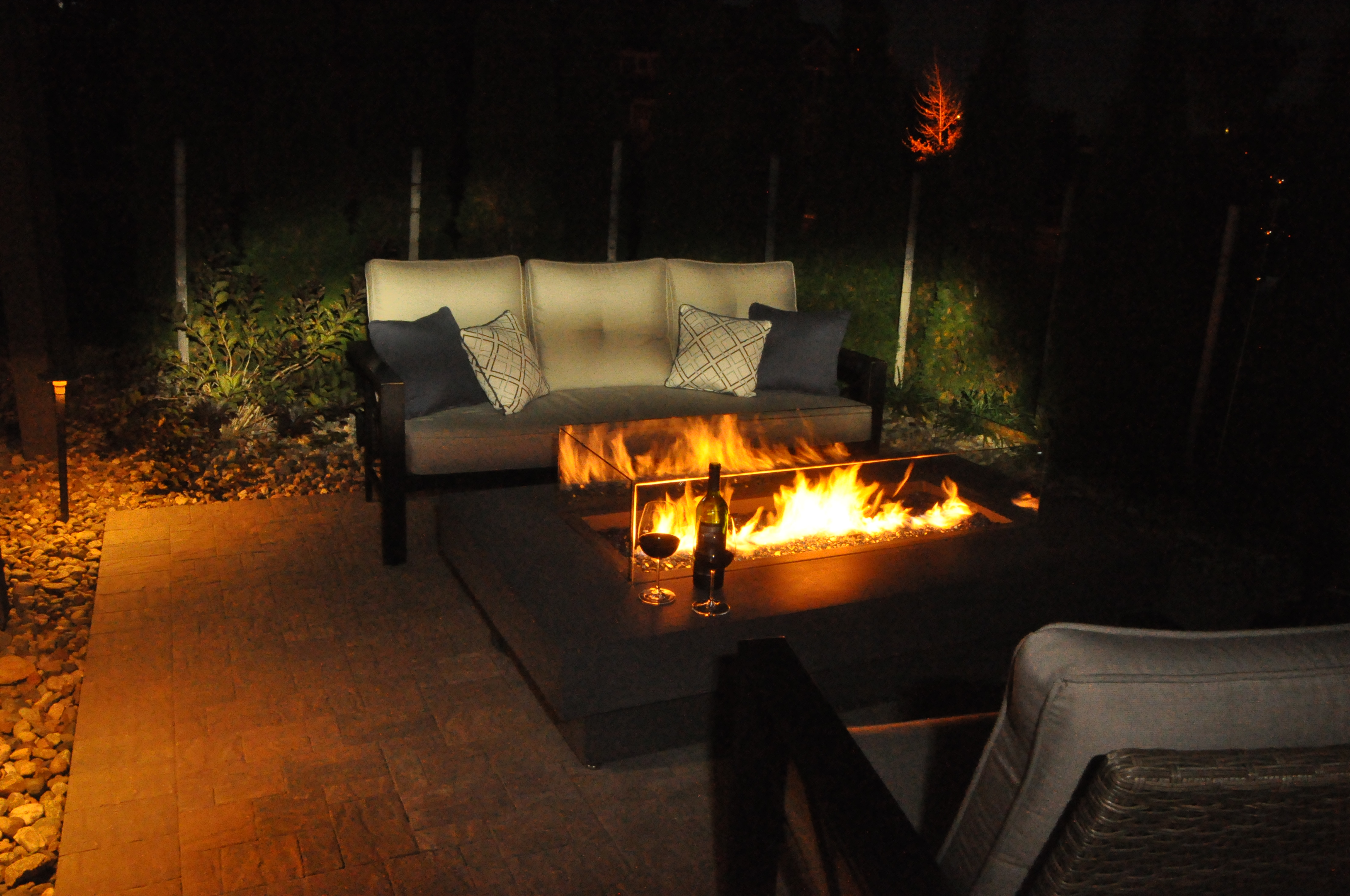 Whether a romantic gathering of two or an evening of many, a fire pit adds warmth to the atmosphere. Designed by Steve Bauer and installed by Embassy Landscape Group.