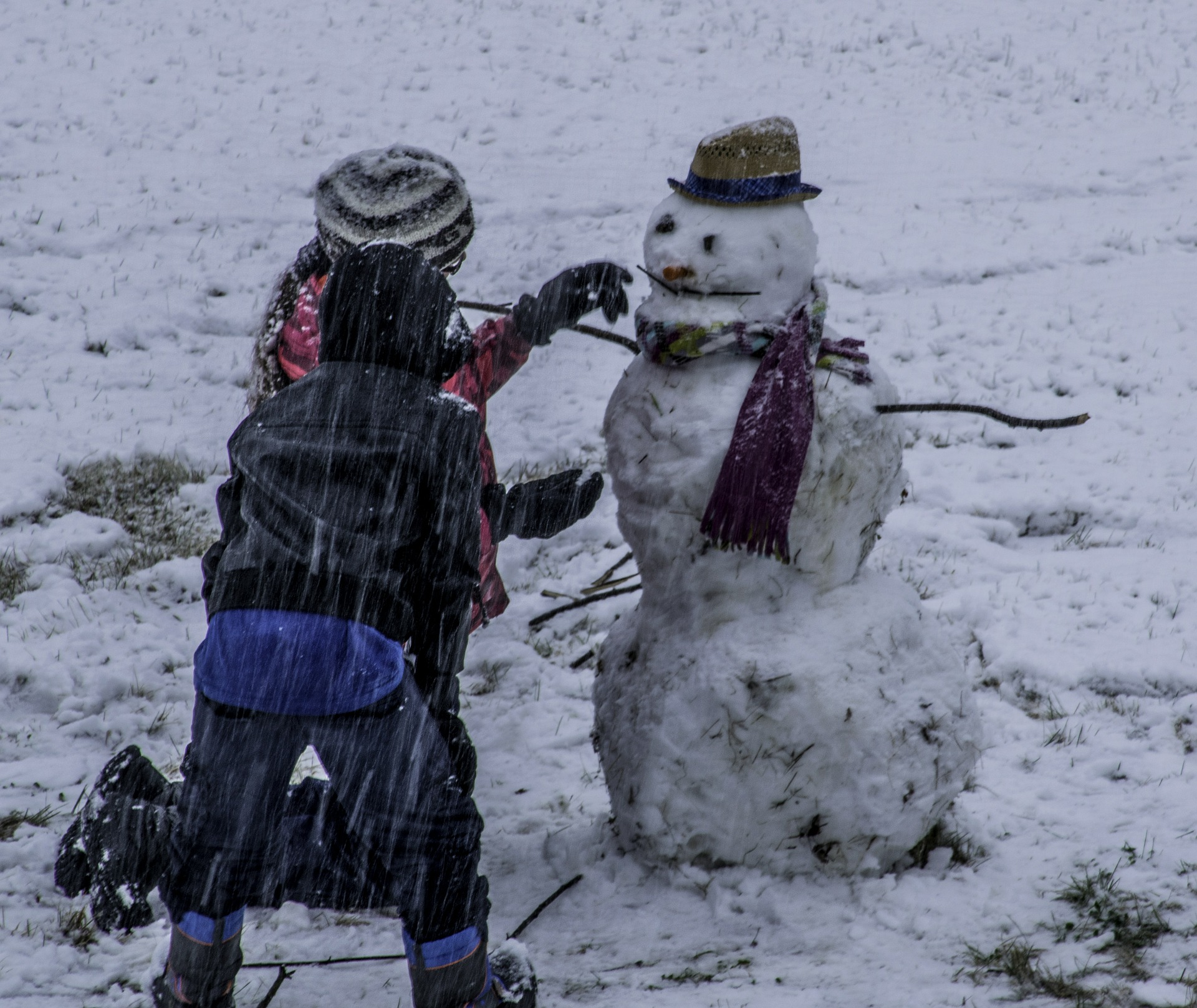 Snowmen and snowball fights are some of the joys of winter.